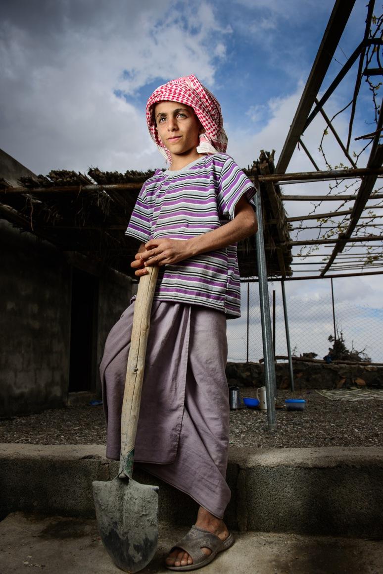 Omani boy from Al Khitaym village in Jabl Shams  standing proud