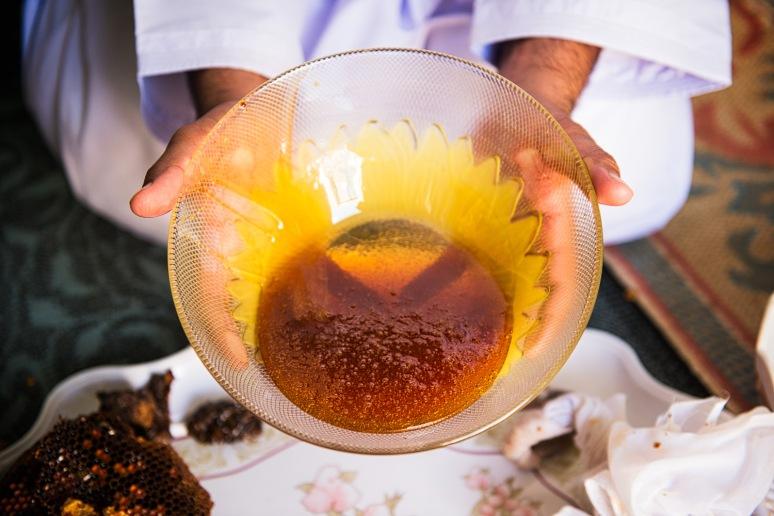 Awad presenting a fresh ball of Omani honey